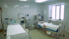 Patient in a bed in intensive care unit Stock Footage