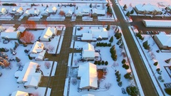 Stunning aerial view of houses, suburb under first snow Stock Footage
