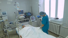Unrecognizable doctor Resuscitating Elderly Patient in intensive care unit Stock Footage