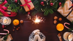Christmas table decorated with a background of hands holding a Sparkler Stock Footage