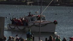 Santa Arriving by Boat to Parade Stock Footage