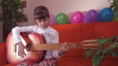 Child with guitar Stock Footage