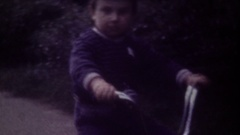Family Chronicle: Happy toddler riding his bike Stock Footage