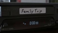 VHS Family Trip Video Tape being put into Old VCR and Ejected Close Up. Stock Footage