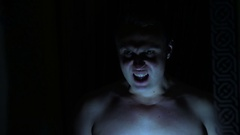 A muscular man screaming. Arkistovideo