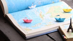 Summer holidays, vacation, travel and trip. idea. Paper boats on the map and the Stock Footage