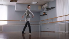 Young man dancing beautifully Contempo dance in a large, bright studio Stock Footage