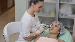 Young woman getting ultrasonic facial cleansing in cosmetology salon Stock Footage