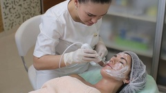 Beautician in medical gloves doing skin treatment with ultrasonic machine Stock Footage