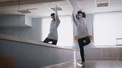 Rehearsal hall. The dancer rehearses dance a modernist style. He is dressed in Stock Footage