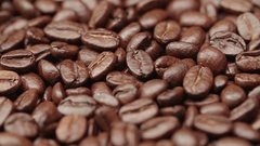 Beautiful background of roasted coffee beans rotating in slow motion Stock Footage