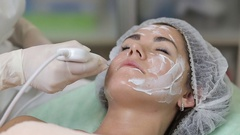 Young woman getting ultrasonic deep facial cleansing in cosmetology salon Stock Footage