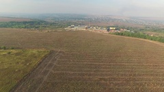Plowed field with hay aerial view. Shooting copter Stock Footage