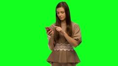 She swears by phone Stock Footage