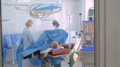 Operating theatre. Medical staff in the opearing room performing surgery Arkistovideo