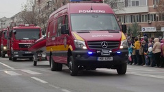 Firetrucks parade during celebrations for National Day of Romania Stock Footage