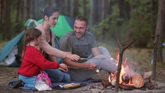 Family rest in the nature with their little son and daughter, they cook Stock Footage