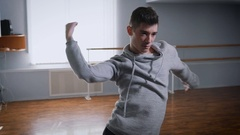 Hall for a rehearsal. The dance teacher rehearses the movements on the jazz to a Stock Footage