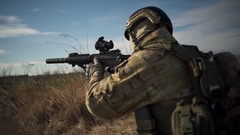 Airsoft soldier wearing full NATO ammunition loading and unloading the rifle Stock Footage