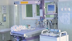 Newborn at a neonatal Intensive Care Unit, monitoring equipment monitors Stock Footage