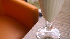 Milkshake with peach and cream Stock Footage