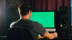 Working late. Confident young man  on his laptop PC with chroma key green screen Stock Photos