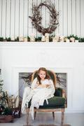 Portrait of 7 years old child reading book at home on christmas Stock Photos