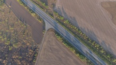 Panoramic shooting highway is lost between a plurality of fields Stock Footage