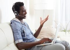 Black man listening music. Stock Photos
