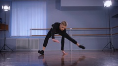 Close up of young hip-hop dancer in black trousers and pullover performing Arkistovideo