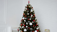 Family around christmas tree. New Year's holidays Stock Footage