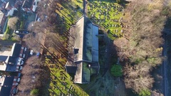 Tilting aerial view of an beautiful Anglican church in a residential area. Stock Footage