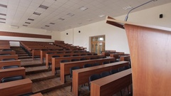 Overview lecture hall with podium for speeches. Conference hall Stock Footage