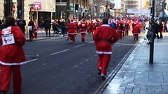 The annual Santa Run for charity on the streets of Liverpool UK Stock Footage