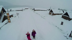 WS AERIAL View of Tourist in Hemu village in snow day,Xinjiang,China. Stock Footage