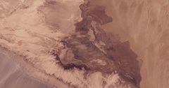 High-altitude overflight aerial of Iran's Dasht-e Kavir (Great Salt Desert) Stock Footage