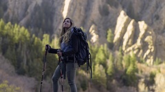Adventurous Female Backpacker Takes In Mountain Views, Turns Around Stock Footage