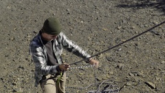 Happy Young Man Belays His Climbing Partner, Pulls Rope, Gives Encouragement Stock Footage