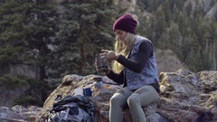Female Backpacker Prepares Meal, Lights Small Camp Stove And Adds Water To Pot Stock Footage