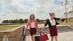 Young girls students running with a barefoot pleasure, having finished the Stock Footage