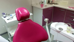 Dental office. Pink dental chair. Dentistry. The movement of the dental chair. Stock Footage