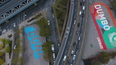 An aerial shot of traffic passing through DUMBO, Brooklyn - NYC - 4k Stock Footage