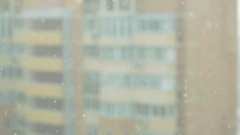 Look at the snow from the windows of skyscrapers urban Stock Footage