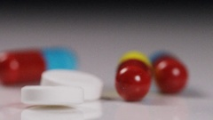 Close up of mix of different medication falling in slow motion Stock Footage