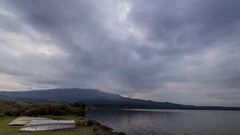 Lake Rotoaira timelapse with fast clouds and Mount Tongariro in the background Stock Footage