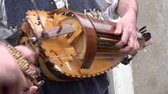Close up of a man playing the hurdy-gurdy Stock Footage