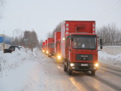 KAZAN, RUSSIA - Festive Christmas caravan of Coca-Cola trucks Stock Footage