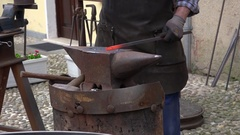 Blacksmith forging iron avil. Stock Footage