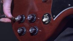 Guitarist playng electrical guitar in studio Stock Footage