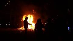 People gathering around a bonfire on Guy Fawkes night Stock Footage